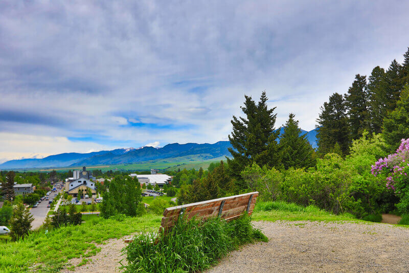 beautiful hill in bozeman montana, with a bench to enjoy the view