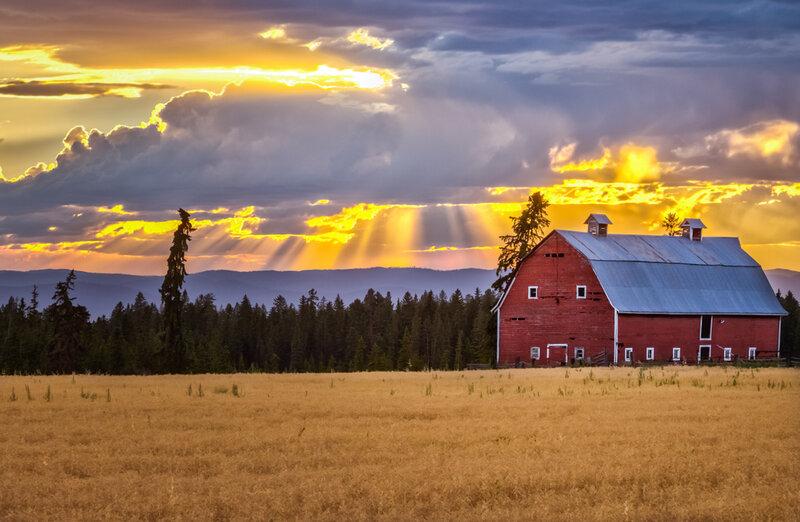 Barn house against a breathtaking sunset in Bigfork Montana