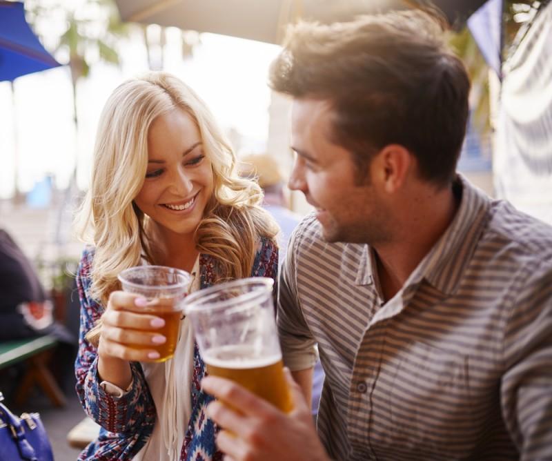 couple drinking beer in restaurant